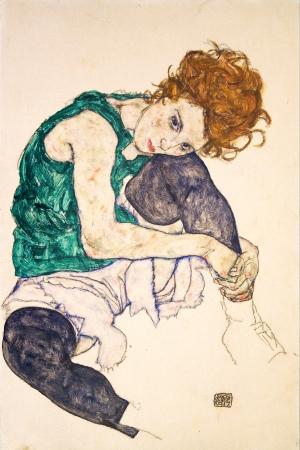 אישה עם רגליים משוכות