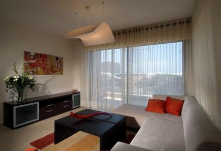 עיצוב של סלון בדירה לדוגמא במגדל מ | עיצוב פנים