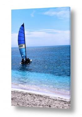 תמונות לפי נושאים קובה | דוגית נוסעת מפרשה אחד