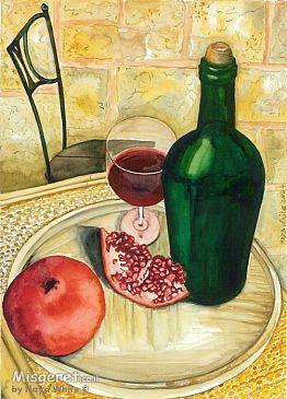 רימונים וכוס יין