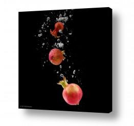 אוכל פירות | רימונים במים