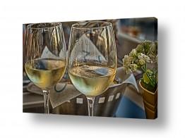 תמונות למסעדות | שתי כוסות יין לבן